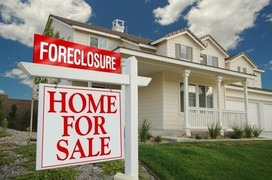 Foreclosure Home For Sale Sign and House.