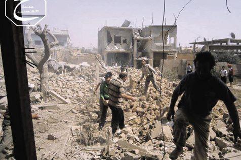 Après un raid aérien gouvernemental sur Al-Qousseir (province de Homs) le 18 mai 2013
