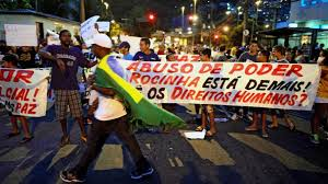 Des habitants des favelas, le 11 juillet 2013