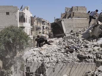 2013-07-27T131020Z_1273636338_GM1E97R1MPF01_RTRMADP_3_SYRIA-CRISIS_0