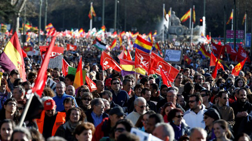 "Anti-austerity demonstrators take part in a demonstration which organisers have labelled the ""Marches of Dignity"" in Madrid, March 22, 2014.  Tens of thousands of protesters converged on Madrid arriving from several parts of the country to protest against government cuts,  and to demand the government not to pay the Troika debt, and call for affordable housing and jobs for all.   REUTERS/Paul Hanna  (SPAIN - Tags: POLITICS CIVIL UNREST) - RTR3I5Y2"