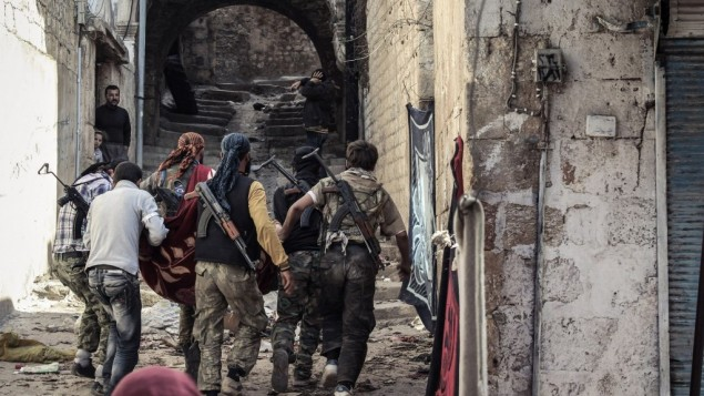 Combattants à Harem, à 30 kilomètre d'Al-Dana