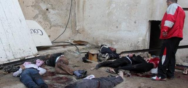 Des corps, mains menottées et yeux bandés, retrouvés dans un centre de l'EIIL, le 8 janvier 2014, à Alep