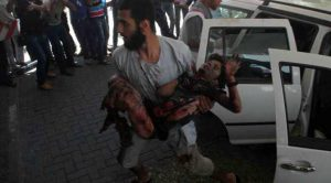 gaza-father-brings-injured-son-to-hospital-victim-of-jewish-military-attack-2014-apa-images-800