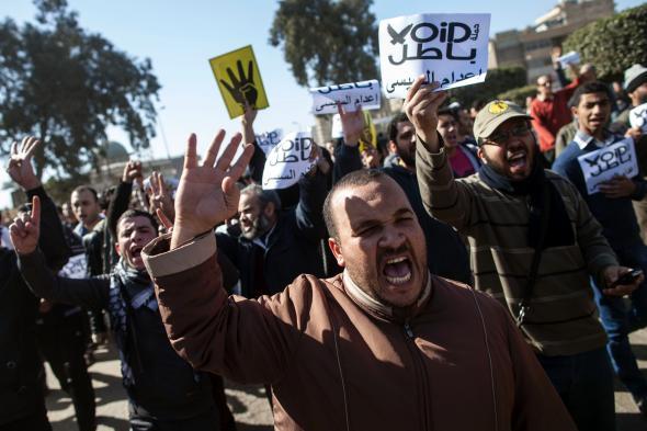 Mars 2014, manifestation des Frères musulmans, avec les 4 doigts levés en rappel du massacre de Rabaa al-Adawiya
