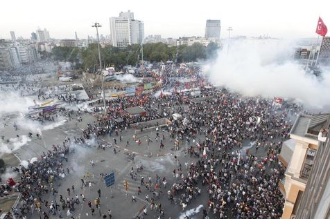 526601-protesters-run-as-riot-police-fire-teargas-during-a-protest-at-taksim-square