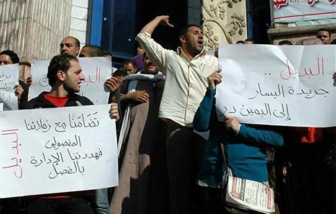 Manifestation, fin août, de journalistes licenciés devant le siège de leur syndicat immobile