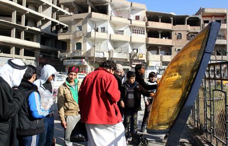 Habitants de Raqqa en décembre 2014 (AFP)