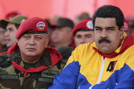 Venezuela's President Nicolas Maduro and national assembly president Diosdado Cabello attend a military parade to commemorate the 23rd anniversary of the failed coup attempt by late president Hugo Chavez in Caracas