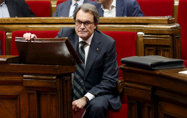 Catalan acting President Artur Mas looks on during the election session for a new President at Catalunya's Parliament in Barcelona