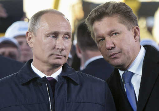 Vladimir Poutine et le patron de Gazprom Alexei Miller