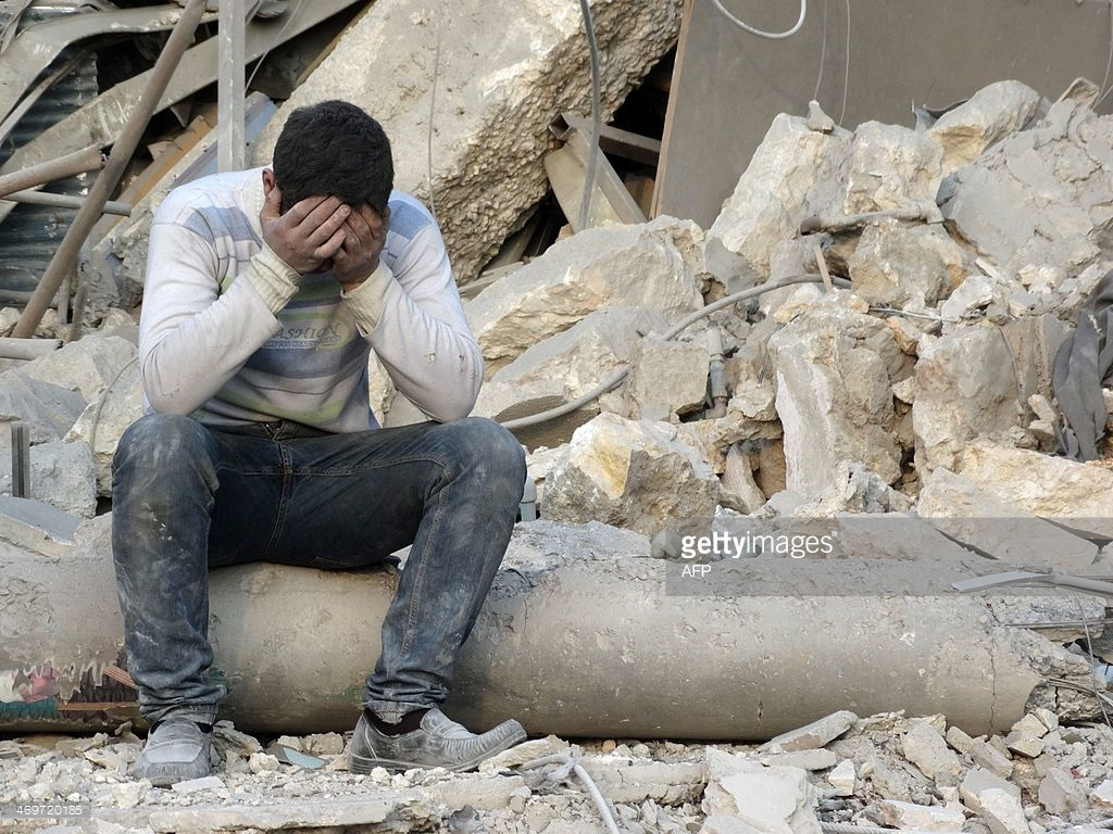 man-reacts-to-the-destruction-in-the-northern-syrian-city-of-aleppo-picture-id469720185
