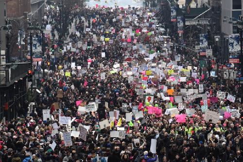 People participate in a Women's March to protest against U.S. President Donald Trump in New York City