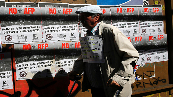 A demonstrator takes part in a protest against national pension system, in Valparaiso