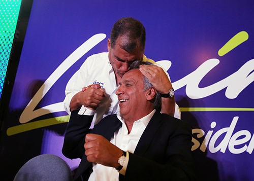 Ecuador's President Rafael Correa kisses Lenin Moreno, candidate of the ruling PAIS Alliance Party, at the Hotel Colon during the presidential election in Quito