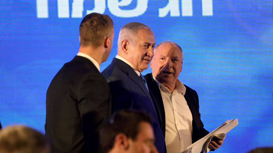 Israeli Prime Minister Benjamin Netanyahu attends a Likud Party gathering marking the first day of the eight-day Jewish holiday of Hanukkah, in Ramat Gan