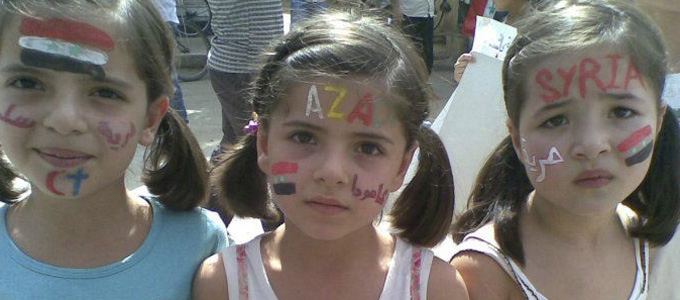 Young girls take part in a demonstration against Syria's President Bashar al-Assad  in Amude