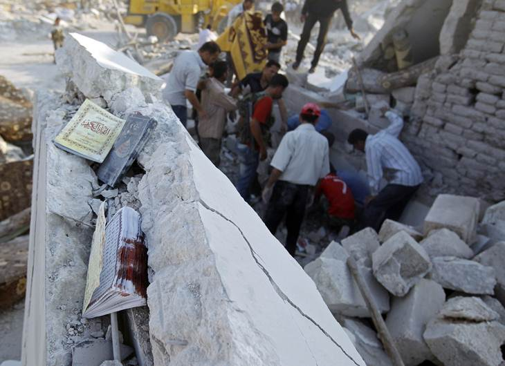 Men search for survivors after a recent Syrian Air force air strike in Azaz