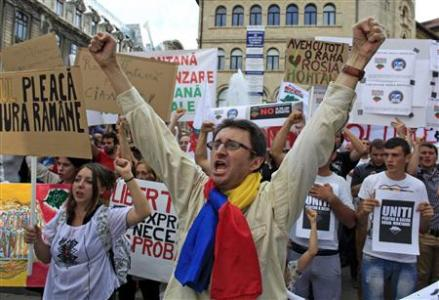 Protesters shout slogans during a demonstration against the opening of the Rosia Montana open cast gold mine in Bucharest