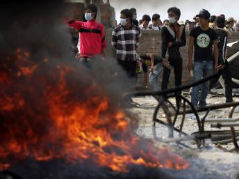 2014-01-03T070433Z_2031104100_GM1EA1315S701_RTRMADP_3_CAMBODIA-PROTEST_0