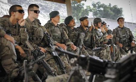 afghan-soldiers-sit-alongside-us-soldiers-during-a-pre-patrol-briefing-in-afghanistan-on-june-26