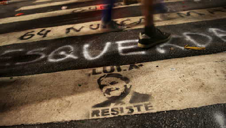 Caricature of former Brazilian President Lula da Silva, that reads «Lula Resits» is pictured on the ground  during a demonstration in support of Brazil's President Rousseff's appointment of him as her chief of staff at Paulista avenue in Sao Paulo