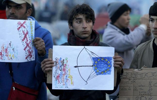 648x415_migrants-brandissent-dessins-alors-ue-turquie-negociation-bruxelles-propos-migrants-18-mars-2016-frontiere-macedo-grecque-idomeni