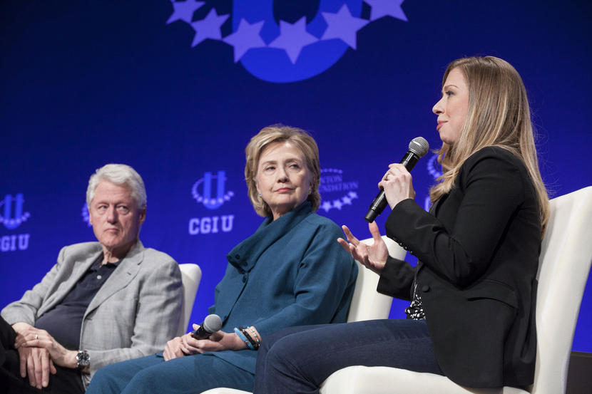 Bill Clinton and Hillary Clinton listen to Chelsea Clinton at the 2014 Meeting of the Clinton Global Initiative in Tempe