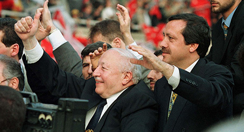 TURKISH PRIME MINISTER ERBAKAN WAVES TO SUPPORTERS WHO FETE OTTOMAN ISTANBUL CONQUEST