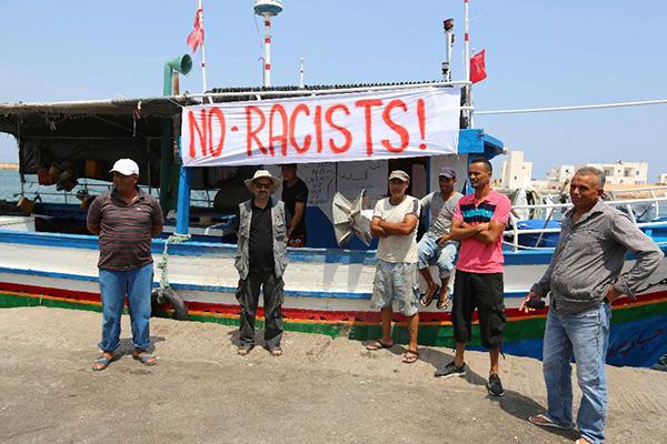 Tunisian fishermen gather on August 6