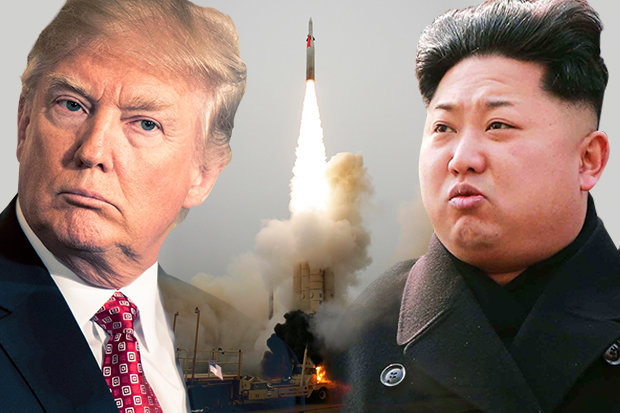 Trump-and-Kim-Jong-un-with-missile-launching-in-between-them-606059