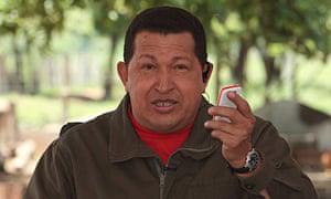 Hugo-Chavez-holds-a-mobil-006